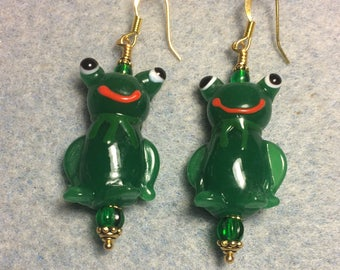 Large green lampwork frog bead earrings adorned with green Czech glass beads.