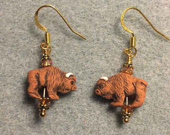 Small brown ceramic buffalo bead earrings adorned with small orange brown Chinese crystal beads.