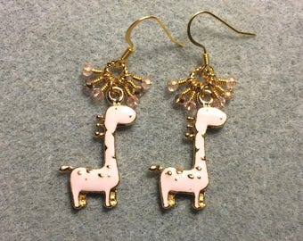 Light pink spotted enamel giraffe charm earrings adorned with tiny dangling pink and gold Chinese crystal beads.