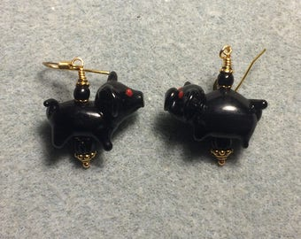 Black lampwork pig bead earrings adorned with black Czech glass beads.