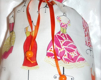 Pouch for storing lingerie fine theme Mannequins ecru background orange and Fuchsia