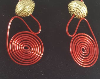 Red hot hand twisted wire wrapped spiral earrings with large gold bead. Flash sale tonight through tomorrow night.