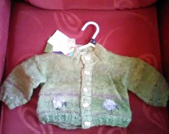 Hand knitted cardigan, knitted in home spun wool to fit a child aged 3-6, months old