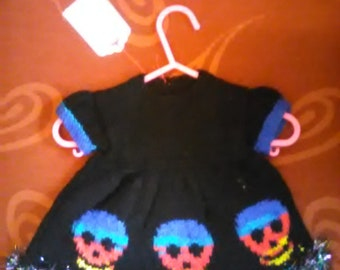 Hand knitted Skull themed dress to fit a newborn baby girl