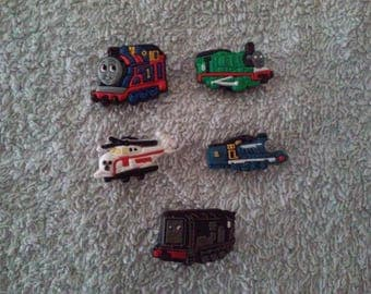 Lot 5 jibbitz Thomas and friends (badges for fangs)