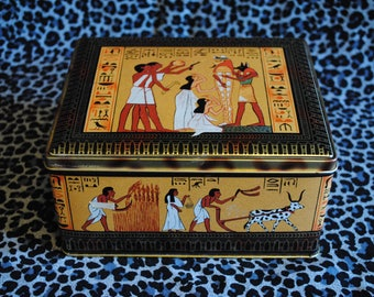 Vintage square tin featuring Egyptian design