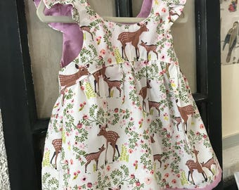 woodland print floral + deer print dress with flutter sleeve + purple lining // baby, toddler, or little girl size.  100% cotton fabric.