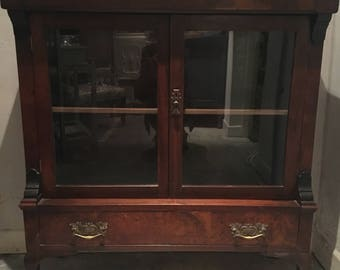 Mahogony glass front display cabinet with bottom drawer