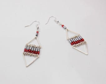 Earrings are made of silver metal, Hematite tube beads and red beads