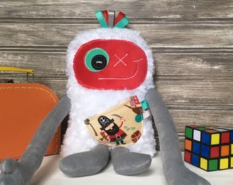 Monstre à Câlins with ribbons,handmade plush,red and grey with pirate print pocket,  baby shower or birthday gift for boy,ready to go.