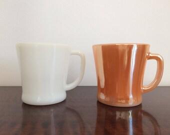 2 fire king mugs 1950's peach lustre white