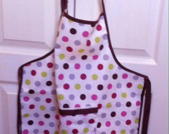 Coated fabric apron with polka dots girl