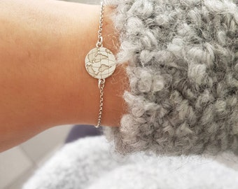 Bracelet with sterling silver chain and globe charm