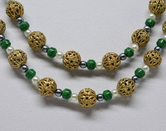 Gorgeous gold and green tone beaded necklace