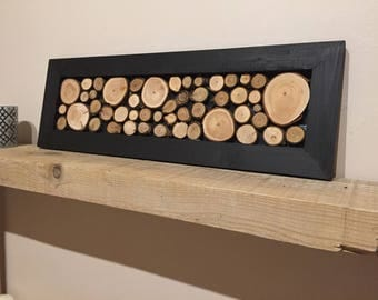 Small table with black frame composed of logs [logs - Nature - rustic - wood]