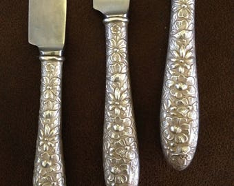 Three Repousse Dinner Knives