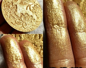 Pot Of Gold.Wet look high shine highlighter. A perfect yellow gold.Dupe for Fenty TrophyWife. Perfect For all skin tones.
