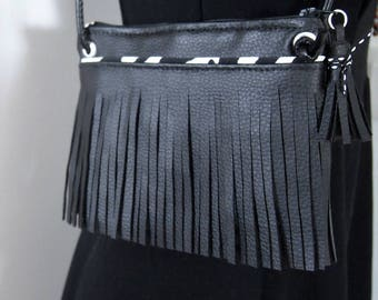 Zebra clutch with fringe in black imitation leather and fabric