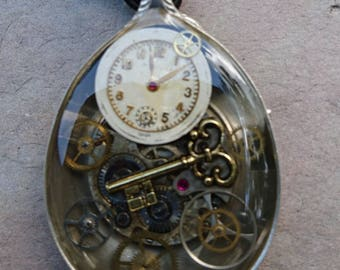 antique EPNS spoon with vintage watch movement in jewellery grade resin with key charm