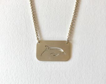 Handpierced Surfacing Dolphin Necklace