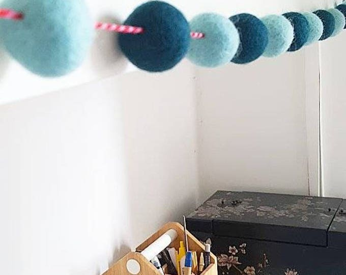 teal and turquoise felt ball garland