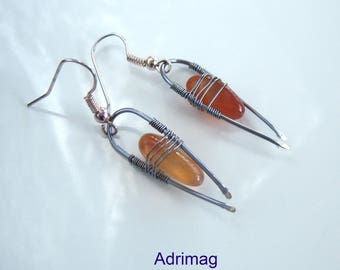 Wire wrap earrings and a stick of carnelian
