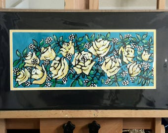 Bright roses in yellow vase