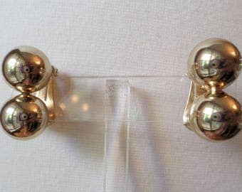 SPERRY Signed, Gold Tone Clip on Earrings.