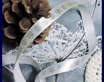 Silver snowflakes in white satin ribbon