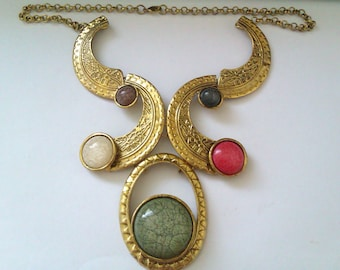 gold coloured tribal style necklace