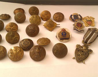 collection of vintage buttons and brooches/badges