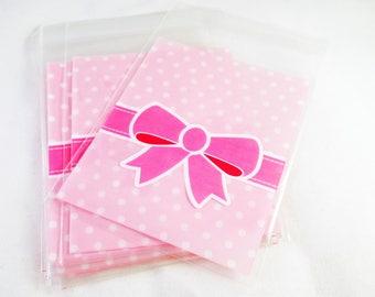 AD07 - Set of 5 bags self-adhesive plastic pockets pink polka with loop