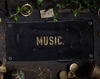 MUSIC. Brass letters on UPCYCLING JEANS in the used - industrial - vintage look