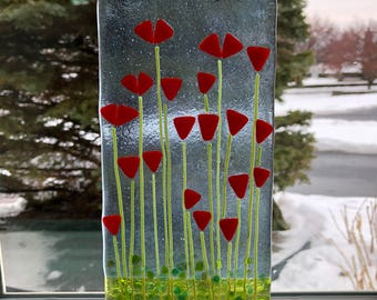 Fused glass suncatcher with red flowers
