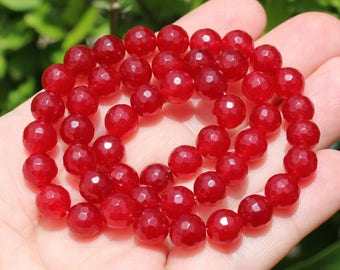 4 RUBY BEADS HAVE FACETED 8 MM AB *.
