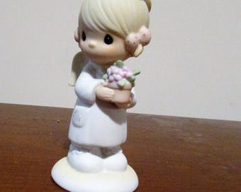 Precious Moments Angel of Mercy figurine #102482