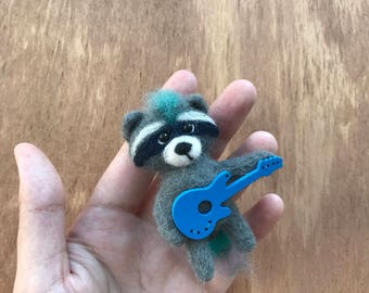 Needle felted facoon brooch