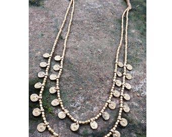 Delicate brass jewelry with brass pendants