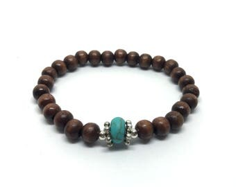Wooden bracelet with Turquoise bead and silver