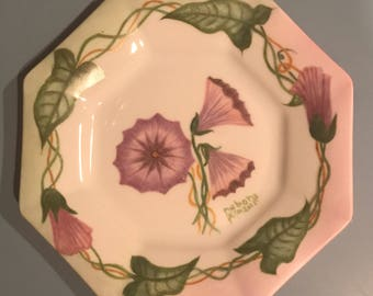 A beautiful trumpet flower hand painted on an octagonal china plate