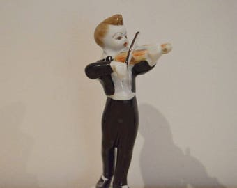 Hollohaza Hungarian porcelain figurine boy playing the violin. In perfect condition