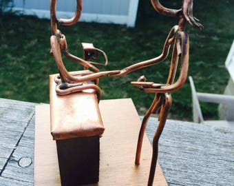 Copper Art Figurine of a Nurse/ medical assistant  with patient