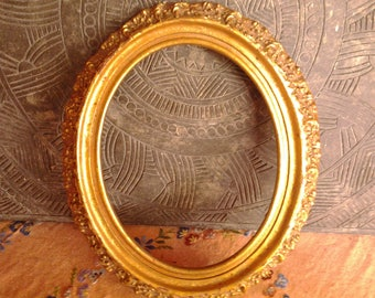 Giilded oval frame