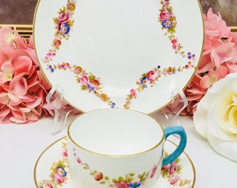 English bone china teacup and saucer with dessert plate trio.