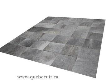 Gray handmade cowhide patchwork rug.