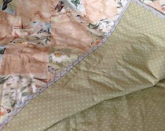 Bird and beige quilt
