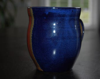 14 oz. hand thrown coffee mug - blue, red, and gold