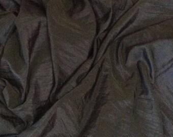 Wrinkled navy taffetas fabric