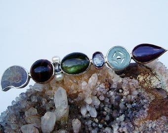 Spillone unico,con ammonite,occhio di tigre,labradorite,tanzanite,giada,radice di rubino