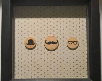 A handmade frame with hat, moustache and glasses